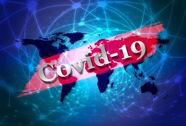 COVID-19 banner across an image of the world