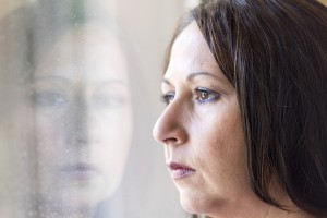 woman looking sad out of window