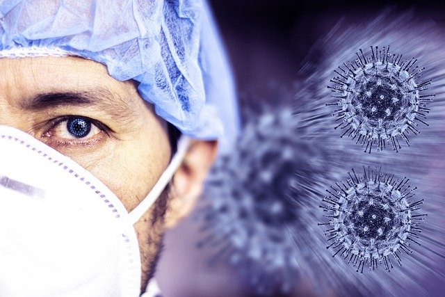 masked man with image of coronavirus in the background